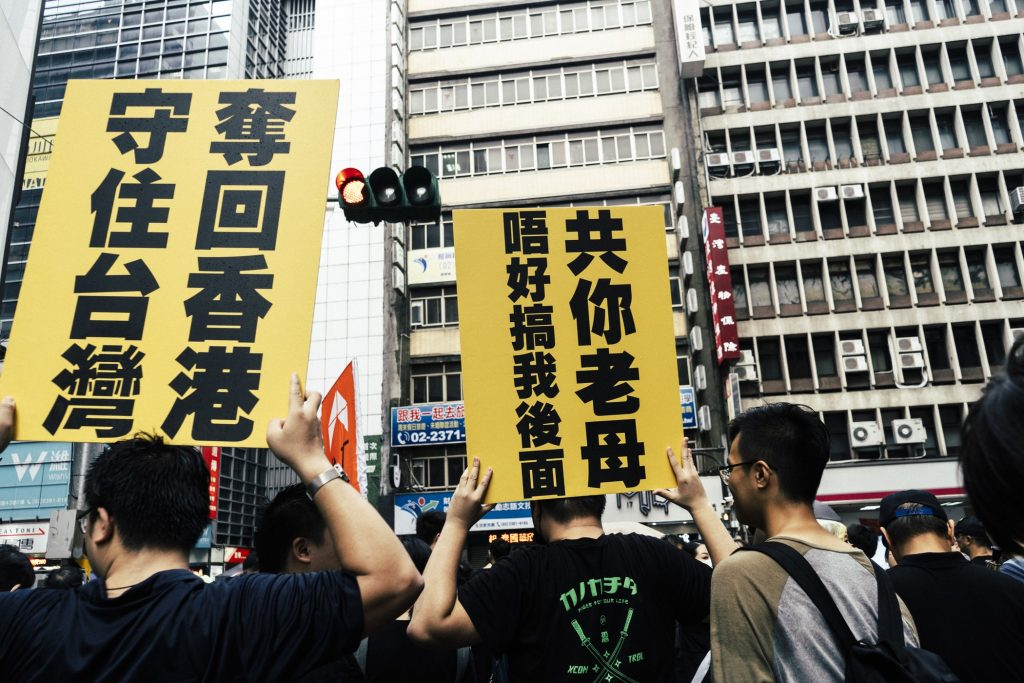 People holding posters during protests in Hong Kong