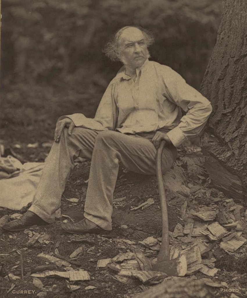 A photograph of William Ewart Gladstone sitting outdoors, on the ground.